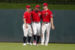 Minnesota Twins outfielders, from left to right, Rob Refsnyder, Byron Buxton and Max Kepler celebrate their win over the Milwaukee Brewers in a baseball game Friday, Aug. 27, 2021, in Minneapolis. (AP Photo/Jim Mone)