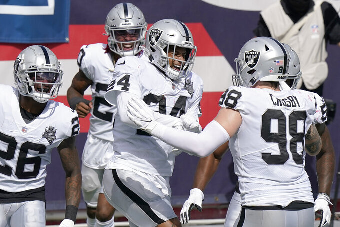 Las Vegas Raiders safety Johnathan Abram (24) celebrates his interception with teammates in the first half of an NFL football game against the New England Patriots, Sunday, Sept. 27, 2020, in Foxborough, Mass. (AP Photo/Steven Senne)