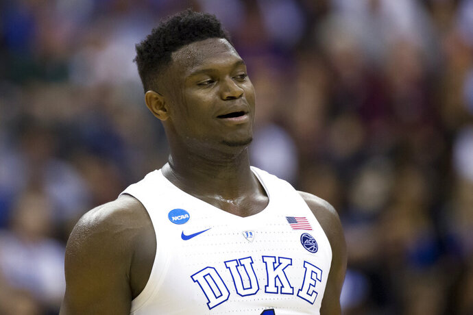 FILE - In this March 29, 2019, file photo, Duke forward Zion Williamson (1) reacts during an East Regional semifinal in the NCAA men's basketball tournamenet against Virginia Tech in Washington. Williamson was named the John R. Wooden Men's Player of the year at the College Basketball Awards ceremony in Los Angeles on Friday, April 12, 2019. (AP Photo/Alex Brandon, File)