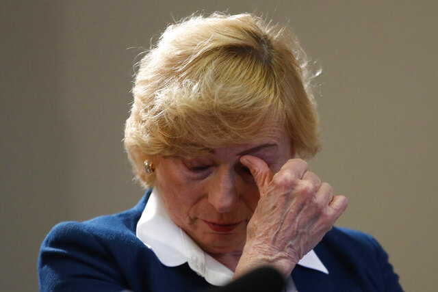 Maine Gov. Janet Mills wipes a tear after becoming emotional before signing papers to posthumously pardon Don Gellers, a Passamaquoddy tribal lawyer convicted of marijuana possession, Tuesday, Jan. 7, 2020 at the Statehouse in Augusta, Maine. (AP Photo/Robert F. Bukaty)