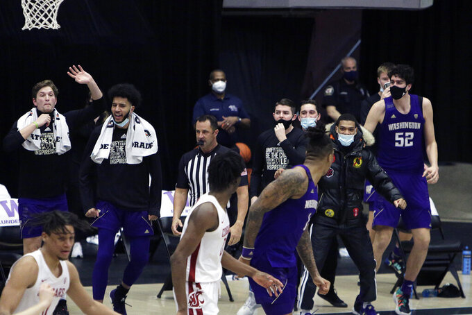 The Washington bench celebrates guard Marcus Tsohonis', not pictured, go ahead basket during the second half of an NCAA college basketball game against Washington State in Pullman, Wash., Monday, Feb. 15, 2021.  (AP Photo/Young Kwak)