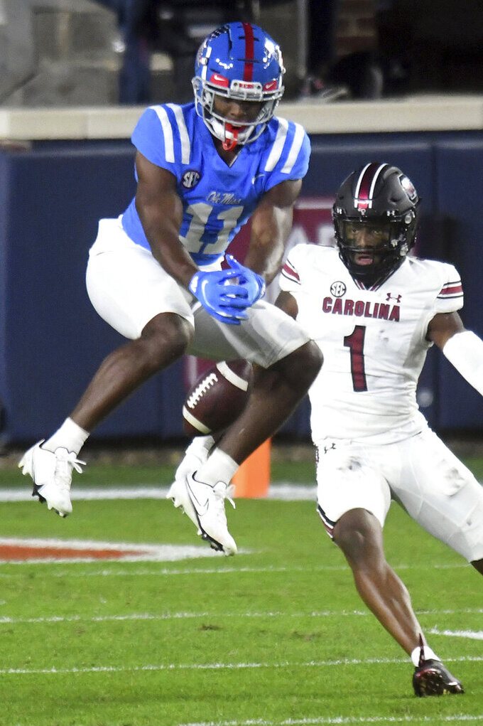 Mississippi wide receiver Dontario Drummond (11) drops a pass as South Carolina defensive back Jaycee Horn (1) defends during the first half of an NCAA college football game in Oxford, Miss., Saturday, Nov. 14, 2020. (AP Photo/Bruce Newman)