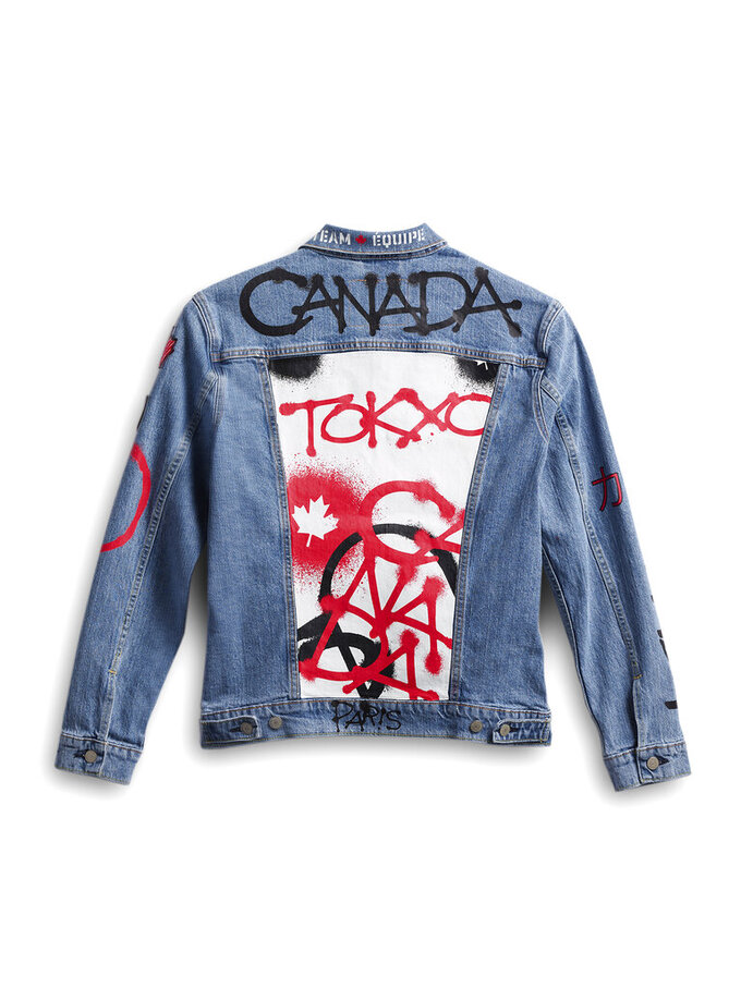 This image provided by Hudson's Bay shows Team Canada's denim jacket to be worn by athletes in the closing ceremony of the Tokyo Olympics. Olympic gear makes for lively social media fodder, starting with the hours-long Parade of Nations. The year's wait due to the pandemic has given enthusiasts extra time to ponder what they love or hate. (Hudson's Bay via AP)