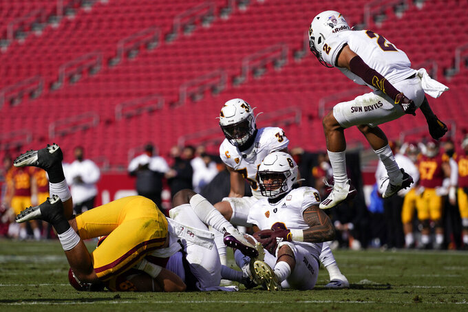 Arizona State defensive back DeAndre Pierce (2) jumps up in celebration after defensive back Evan Fields (4) caught an interception during the first half of an NCAA college football game against Southern California, Saturday, Nov. 7, 2020, in Los Angeles. (AP Photo/Ashley Landis)