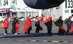 Staff board a U.S. Air Force C17 as they prepare to take the season's first flight to McMurdo Station in Antarctica from Christchurch Airport, New Zealand, Monday, Sept. 14, 2020. The first U.S. flight into Antarctica following months of winter darkness left from New Zealand Monday with crews extra vigilant about keeping out the coronavirus. (AP Photo/Mark Baker)