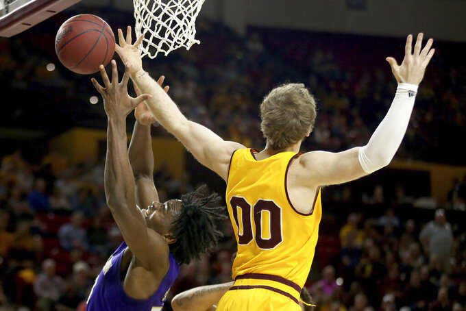 Arizona State's Mickey Mitchell (00) and Washington's Isaiah Stewart (33) reach for a rebound during the first half of an NCAA college basketball game Thursday, March 5, 2020, in Tempe, Ariz. (AP Photo/Darryl Webb)