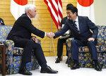 U.S. Vice President Mike Pence, left, meets Japanese Prime Minister Shinzo Abe at Abe's official residence in Tokyo Tuesday, Nov. 13, 2018. (AP Photo/Eugene Hoshiko)