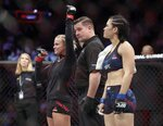 Paige Vanzant, left, celebrates after beating Rachael Ostovich in a women's flyweight mixed martial arts bout at UFC Fight Night Saturday, Jan. 19, 2019, in New York. Vanzant stopped Ostovich in the second round. (AP Photo/Frank Franklin II)