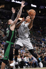 San Antonio Spurs' DeMar DeRozan (10) shoots against Boston Celtics' Daniel Theis during the first half of an NBA basketball game, Saturday, Nov. 9, 2019, in San Antonio. (AP Photo/Darren Abate)