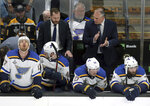 St. Louis Blues head coach Craig Berube, right rear, exhorts his players during the first period in Game 5 of the NHL hockey Stanley Cup Final against the Boston Bruins, Thursday, June 6, 2019, in Boston. (AP Photo/Charles Krupa)