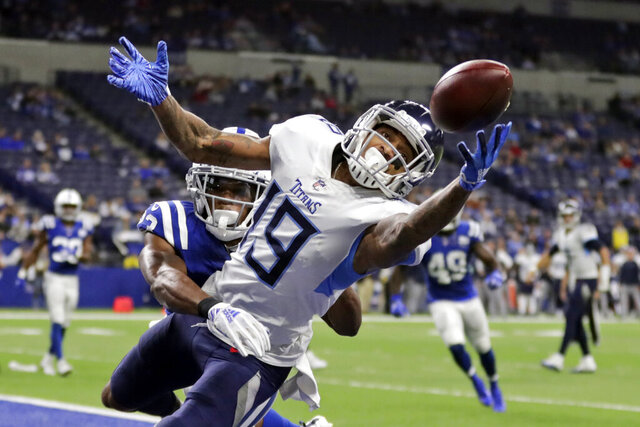 FILE - In this Nov. 18, 2018, file photo, Tennessee Titans' Tajae Sharpe (19) makes a touchdown catch against Indianapolis Colts' Kenny Moore during the second half of an NFL football gam, in Indianapolis. After the departure of Stefon Diggs, the Vikings have turned to Sharpe to fill a startling void at wide receiver. (AP Photo/Michael Conroy, File)