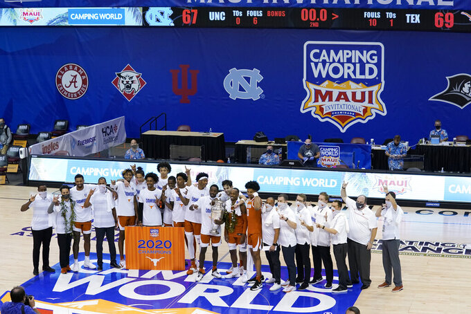 Texas celebrates its 69-67 win over North Carolina in an NCAA college basketball game for the championship of the Maui Invitational, Wednesday, Dec. 2, 2020, in Asheville, N.C. (AP Photo/Kathy Kmonicek)