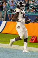 Texas A&M running back Devon Achane (6) runs for a touchdown during the second half of the Orange Bowl NCAA college football game against North Carolina, Saturday, Jan. 2, 2021, in Miami Gardens, Fla. (AP Photo/Lynne Sladky)