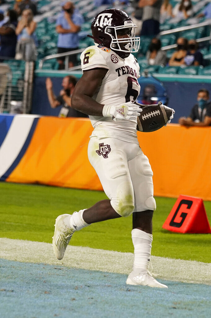 Texas A&M running back Devon Achane (6) runs for a touchdown during the second half of the Orange Bowl NCAA college football game against North Carolina, Saturday, Jan. 2, 2021, in Miami Gardens, Fla. (AP Photo/Lynne Sladky)