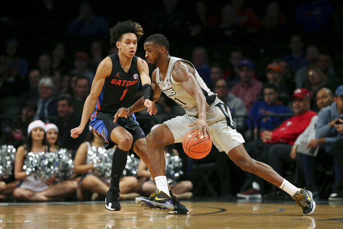 Providence guard Alpha Diallo (11) drives against Florida guard Tre Mann (1) during the first half of an NCAA college basketball game at Barclays Center, Tuesday, Dec. 17, 2019, in New York. (AP Photo/Michael Owens)