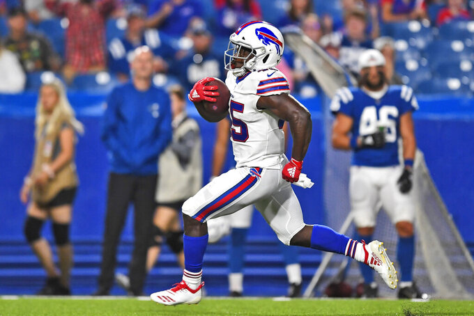"Buffalo Bills' Christian Wade runs the ball for a touchdown during the second half of an NFL preseason football game against the Indianapolis Colts, Thursday, Aug. 8, 2019, in Orchard Park, N.Y. Wade gave up a promising career representing England in rugby to give American football a try. On his first play from scrimmage in a competitive setting, the 28-year-old from Slough _ best known for home of the BBC's version of ""The Office"" sitcom _ scored a touchdown on a 65-yard run to help the Buffalo Bills secure a 24-16 preseason-opening win over Indianapolis. (AP Photo/Adrian Kraus)"