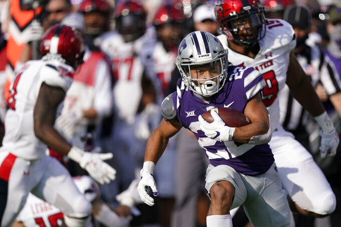 Kansas State running back Deuce Vaughn (22) runs for a first down during the second half of the team's NCAA college football game against Texas Tech on Saturday, Oct. 3, 2020, in Manhattan, Kan. (AP Photo/Charlie Riedel)