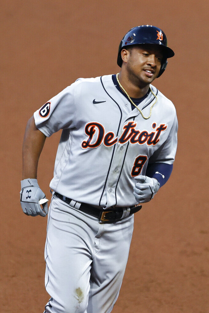 Detroit Tigers' Jonathan Schoop rounds the bases after hitting a two-run home run off Cleveland Indians starting pitcher Adam Plutko during the fourth inning of a baseball game, Friday, Aug. 21, 2020, in Cleveland. (AP Photo/Ron Schwane)
