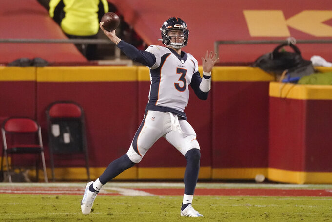 Denver Broncos quarterback Drew Lock throws against the Kansas City Chiefs in the second half of an NFL football game in Kansas City, Mo., Sunday, Dec. 6, 2020. (AP Photo/Charlie Riedel )