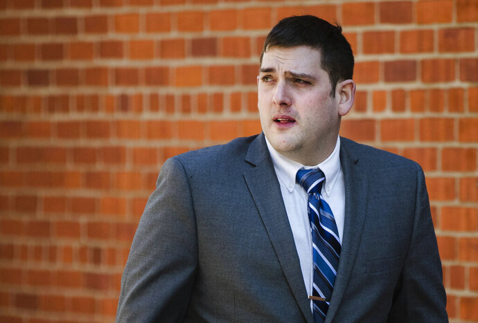 In this March 12, 2019 file photo, former East Pittsburgh police officer Michael Rosfeld, charged with homicide in the shooting death of Antwon Rose II, walks to the Dauphin County Courthouse in Harrisburg, Pa. On the fourth day of the trial in Pittsburgh, Friday March 22, 2019, Rosfeld was acquitted of all counts in the death of Rose. (AP Photo/Matt Rourke)
