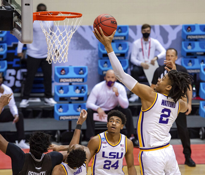 LSU forward Trendon Watford (2) pulls down a rebound during the first half of a first round game against St. Bonaventure in the NCAA men's college basketball tournament, Saturday, March 20, 2021, at Assembly Hall in Bloomington, Ind. (AP Photo/Doug McSchooler)