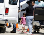 Immigrant families leave a United States Immigration and Customs Enforcement facility after they were reunited, Wednesday, July 11, 2018, in San Antonio. Some immigrant toddlers are back with their parents, but others remained in government custody away from relatives as federal officials fell short of meeting a court-ordered deadline to reunite dozens of youngsters forcibly separated from their families at the border. (AP Photo/Eric Gay)
