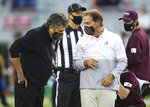 Mississippi State Head Coach Mike Leach, left, and Alabama Head Coach Nick Saban talk before the start of an NCAA college football game in Tuscaloosa, Ala., Saturday, Oct. 31, 2020. (Gary Cosby Jr/The Tuscaloosa News via AP)