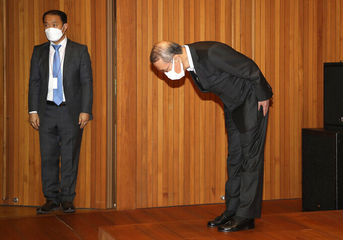 Hong Won-sik, chairman of Namyang Dairy Products, bows in apology during a press conference at the company's headquarters in Seoul, South Korea, Tuesday, May 4, 2021. Hong resigned over a scandal in which his company was accused of deliberately spreading misinformation that its yogurt helps prevent coronavirus infections. (Hwang Gang-mo/Yonhap via AP)