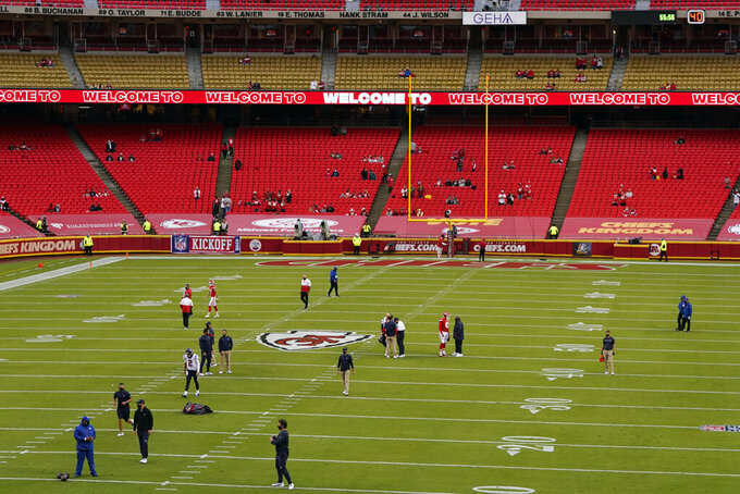 Players warm up before an NFL football game between the Kansas City Chiefs and the Houston Texans Thursday, Sept. 10, 2020, in Kansas City, Mo. (AP Photo/Jeff Roberson)