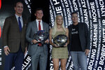 The High School Athletes of the Year, Bobby Witt Jr., second from left, and Kelley Lynch, second from right, poses with their trophies next to former NFL quarterback Peyton Manning, left, and former U.S. women's soccer national team member Abby Wambach, right,Tuesday, July 9, 2019, in Los Angeles. (AP Photo/Marcio Jose Sanchez)
