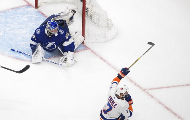 New York Islanders right wing Jordan Eberle (7) celebrates after scoring on Tampa Bay Lightning goaltender Andrei Vasilevskiy (88) during the second overtime in Game 5 of the NHL hockey Eastern Conference final, Tuesday, Sept. 15, 2020, in Edmonton, Alberta. (Jason Franson/The Canadian Press via AP)