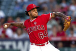 Los Angeles Angels starting pitcher Felix Pena delivers a pitch during the first inning of the team's baseball game against the Houston Astros 1in Anaheim, Calif., Wednesday, July 17, 2019. (AP Photo/Kyusung Gong)