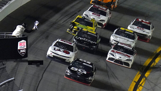 Austin Cindric (22) takes the checkered flag to win a NASCAR Xfinity Series auto race Saturday, Feb. 13, 2021, at the Daytona International Speedway in Daytona Beach, Fla. (AP Photo/Chris O'Meara)