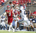 Fresno State quaterback Jake Haener (9) throws a pass past Connecticut linebacker Ian Swenson during the first half of an NCAA college football game in Fresno, Calif., Saturday, Aug. 28, 2021. (AP Photo/Gary Kazanjian)