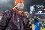 Defensive Coordinator Bud Foster takes the field following a shutout win after the Pittsburgh Virginia Tech NCAA college football game in Blacksburg, Va., Saturday, Nov. 23, 2019. (AP Photo/Matt Bell)