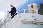 President Donald Trump exits Air Force One at Miami International Airport on Friday, July 10, 2020. (AP Photo/Evan Vucci)