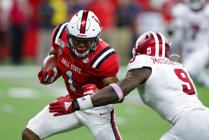 Indiana defensive back Marcelino Ball (9) closes in to tackle Ball State wide receiver Antwan Davis (1) during the first half of a college football game in Indianapolis, Saturday, Aug. 31, 2019. (AP Photo/Michael Conroy)