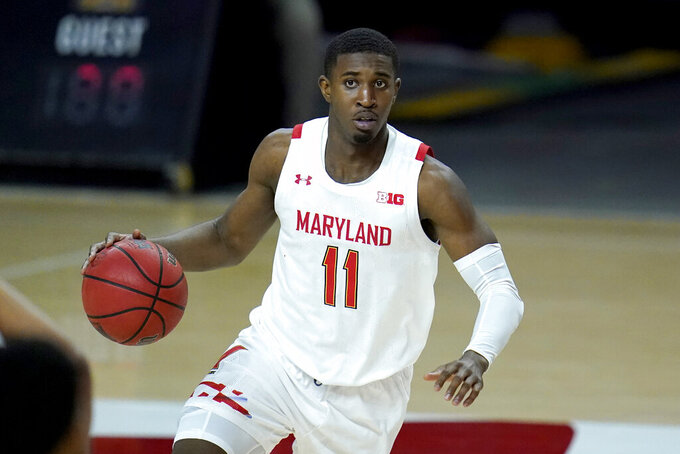 Maryland guard Darryl Morsell works the floor against Nebraska during the second half of an NCAA college basketball game, Wednesday, Feb. 17, 2021, in College Park, Md. (AP Photo/Julio Cortez)