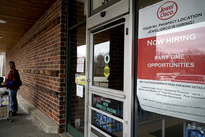 A hiring sign is seen at Jewel Osco in Mount Prospect, Ill., Saturday, April 4, 2020. Essential businesses like grocery stores and delivery services are hiring for thousand of open positions to accommodate overwhelming demand during the coronavirus outbreak. (AP Photo/Nam Y. Huh)