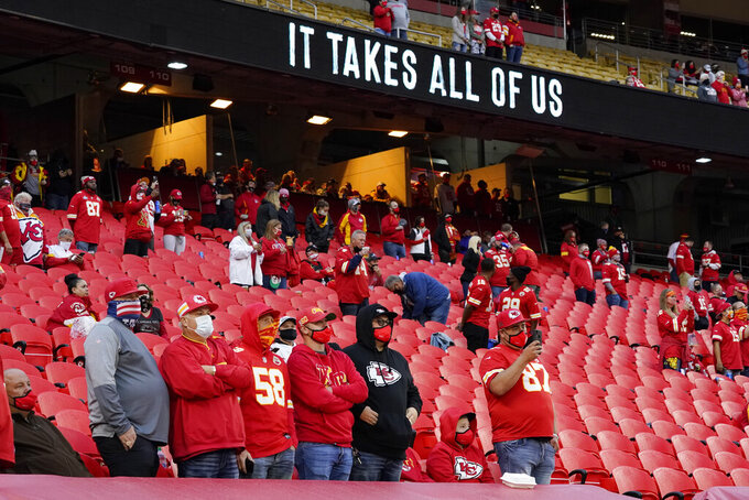 FILE - In this Thursday, Sept. 10, 2020 file photo, fans stand for a presentation on social justice before an NFL football game between the Kansas City Chiefs and the Houston Texans in Kansas City, Mo. The NFL's new stance encouraging players to take a stand against racial injustice got its first test as some fans of the Super Bowl champion Kansas City Chiefs booed during a moment of silence to promote the cause, touching off a fresh debate on how players should use their voice. (AP Photo/Charlie Riedel, File)