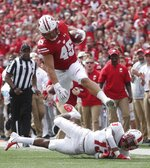 Wisconsin's Alec Ingold tries to jump over New Mexico's Jalin Burrell during the first half of an NCAA college football game Saturday, Sept. 8, 2018, in Madison, Wis. (AP Photo/Morry Gash)