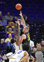 UMBC forward Dimitrije Spasojevic (32) flips the ball over LSU forward Darius Days (0) for two points during the first half of an NCAA college basketball game Tuesday, Nov. 19, 2019, in Baton Rouge, La. (AP Photo/Bill Feig)