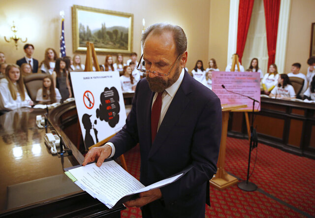 FILE - In this March 27, 2019, file photo, state Sen. Jerry Hill, D-San Mateo, looks over his notes before a news conference in Sacramento, Calif.,  to propose a measure that eventually passed to ban the sale of flavored tobacco products in stores and vending machines in California. Voters will decided in 2022 whether to uphold it after a referendum qualified for the ballot on Friday, Jan. 22, 2021. (AP Photo/Rich Pedroncelli,File)