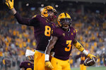 Arizona State running back Rachaad White (3) celebrates his touchdown with tight end Curtis Hodges (86) against Southern Utah during the first half of an NCAA college football game, Thursday, Sept. 2, 2021, in Tempe, Ariz. (AP Photo/Matt York)