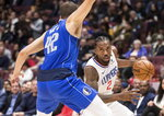Los Angeles Clippers' Kawhi Leonard (2) drives against Dallas Mavericks' Maxi Kleber (42) during the first half of an NBA preseason basketball game Thursday, Oct. 17, 2019, in Vancouver, British Columbia. (Darryl Dyck/The Canadian Press via AP)