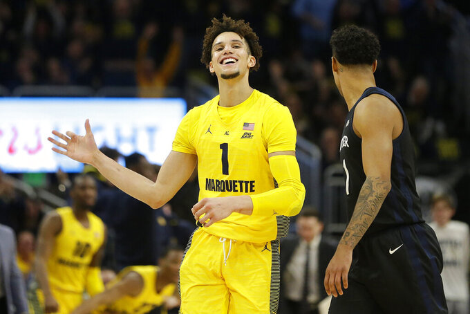 Marquette's Brendan Bailey reacts after making a basket during the second half of an NCAA college basketball game against Butler, Sunday, Feb. 9, 2020, in Milwaukee. (AP Photo/Aaron Gash)