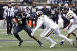 Vanderbilt running back Ke'Shawn Vaughn (5) tries to move past ETSU defensive back Quinn Smith (7) in the first half of an NCAA college football game Saturday, Nov. 23, 2019, in Nashville, Tenn. (AP Photo/Mark Humphrey)