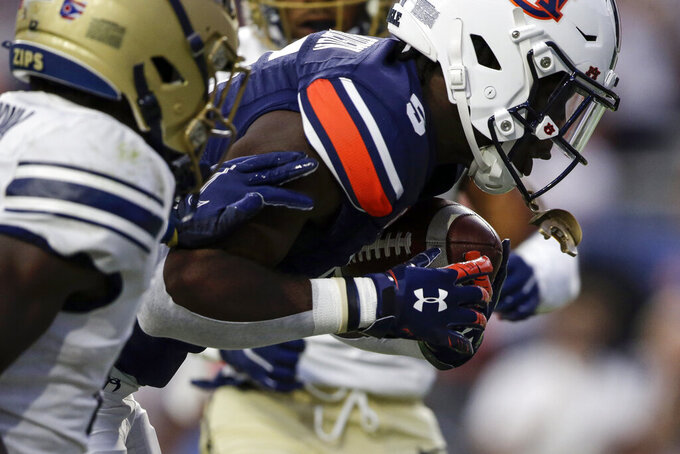 Auburn wide receiver Kobe Hudson (5) catches a pass for a touchdown against Akron during the first half of an NCAA college football game Saturday, Sept. 4, 2021, in Auburn, Ala. (AP Photo/Butch Dill)