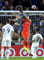 LA Galaxy goalkeeper David Bingham (1) deflects a header by Minnesota United defender Michael Boxall (15) during the first half of an MLS soccer first-round playoff match, Sunday, Oct. 20, 2019, in St. Paul, Minn. (AP Photo/Andy Clayton-King)
