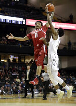 Arkansas guard Desi Sills (0) drives against Vanderbilt forward Aaron Nesmith (24) in the first half of an NCAA college basketball game Wednesday, March 6, 2019, in Nashville, Tenn. (AP Photo/Mark Humphrey)